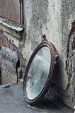 Thrown Out Old Mirror. Standing Against Wall stock photo