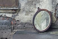 Thrown Out Old Mirror. Standing Against Wall royalty free stock images