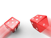 Thrown red dice Stock Images