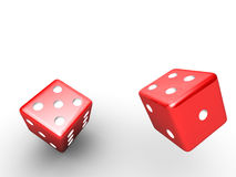 Thrown red dice Stock Photography