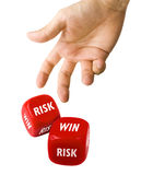 Thrown Red Dice. Male hand throwing red Dice showing risk and win text on isolated on White royalty free stock image