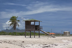 Rescue tower on an empty beach. The thrown tower for rescuers on a far beach Stock Photos