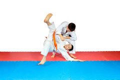 Throws judo perfoming athletes in judogi Royalty Free Stock Images