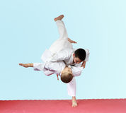 Throws judo two athletes are training on the mat. Throws judo two athletes are training Stock Photos