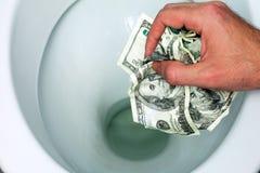 Throws money bills in the toilet