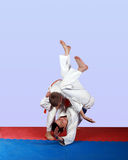 Throws through  the thigh  in the performance of an athlete with an orange belt Stock Images