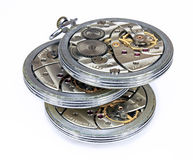 Three similar old pocket watch mechanism isolated Royalty Free Stock Image