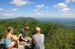 Thru Hikers on the Appalachian Trail. Thru hikers taking a break on top of Bear Mountain in Connecticut on the Appalachian Trail after a long day of hiking Royalty Free Stock Photos