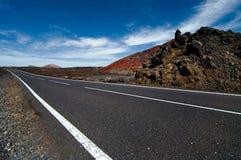 Thrue da estrada o deserto Fotografia de Stock