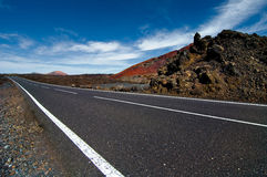 Thrue de route le désert Photographie stock