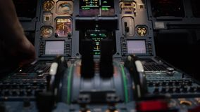 Thrust levers of a twin engined airliner. Thrust levers on the centre pedestal instrument panel. Switches and dials. Visible in the background 4K stock video
