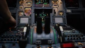 Thrust levers of a twin engined airliner. Thrust levers on the centre pedestal instrument panel. Switches and dials Royalty Free Stock Image