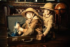 Thrust for travel. Traveler children in a travel suitcases are playing at home. Childhood. Fantasy, imagination stock photography