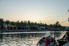 Thu Bon River Hoi An, Vietnam. Hoi An is located on the coast of the South China Sea. Is recognised as a World Heritage Site by UNESCO. Market at night with a Royalty Free Stock Image
