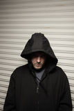 Thug. Man wearing a hood over his head to conceal his true identity Stock Photos