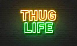 Thug life neon sign on brick wall background. Stock Photo