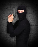 Thug in mask. And gun in his hand Stock Photography