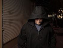 Thug walking the streets Stock Photography