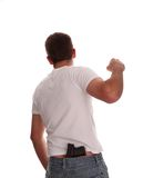 Thug! Young gang member about to strike. Young man about to strike, isolated on white, gun in back of pants Stock Photo