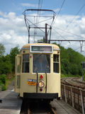 Thuin - June 11: Old heritage streetcar tramway on the bridge over Sambre. Photo taken on June 11, 2017, Thuin, Belgium. Thuin - June 11: Old heritage streetcar Royalty Free Stock Images