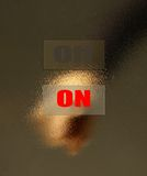Thumb clicks on the button. Royalty Free Stock Images