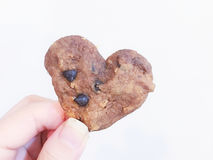 Thumb Cookie. Love Cookie in my Thumb Royalty Free Stock Image