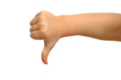 Thumb down. Small hand is showing thumb down Royalty Free Stock Image