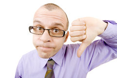 Thumb down. Funny businessman pointing thumb down isolated on white Stock Images