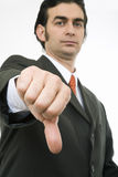 Thumb down. Businessman's thumb pointing down Royalty Free Stock Image