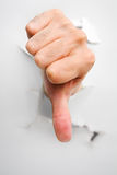 Thumb down from crack wall Stock Photos