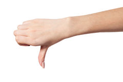 Thumb down Female hand sign isolated on white Royalty Free Stock Photography