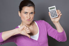 Thumb down for female professional disapproving financial strategy Stock Images