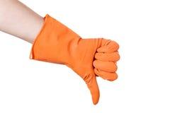 Thumb down in the orange vinyl gloves Royalty Free Stock Photo
