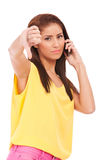 Thumb down on the phone Stock Photography