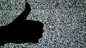 Thumb down and thumb up for like and dislike or Approval and disapproval concept against static TV noise background. 1920x1080 full hd footage stock footage