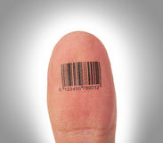 Thumb finger over a white background, barcode Royalty Free Stock Photos