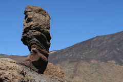 Thumb of God. The Thumb of God of Roques de Garcia mountains and the Teide volcano as a background (Las Canadas national park, Tenerife Royalty Free Stock Image