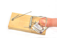 Thumb in money trap Stock Image