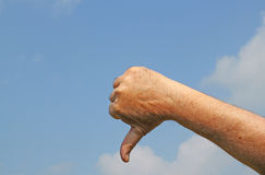 Thumb pointing down. Fail sign. Royalty Free Stock Photography