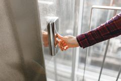 The thumb presses the Elevator button, a hand reaching for the button, the girl waiting for Elevator, push button start.  Royalty Free Stock Image