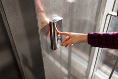 The thumb presses the Elevator button, a hand reaching for the button, the girl waiting for Elevator, push button start stock image