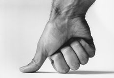 Thumb pressing down (b&w) (close-up) Royalty Free Stock Photo