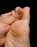 Thumb pressure on big toe massage Stock Images