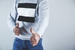 Thumb`s up by a businessman stock images