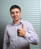 Thumb's up by a young manager Royalty Free Stock Photography