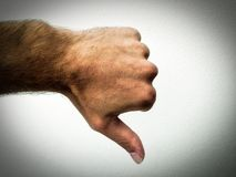 Dislike. Thumb, show down, part of the hand, gesture, dislike, part of the body, white background, caucasian man, finger stock photos