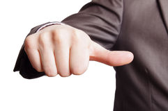 Thumb sign. A suited man showing average thumb sign on white background Royalty Free Stock Photos