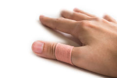 Thumb Sticking with an adhesive Plaster. On isolated whited background Stock Images