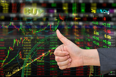 Thumb in stock exchange Stock Photo