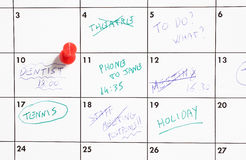 Thumb tack on calendar Stock Image